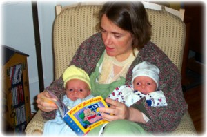 Mom reading to twins